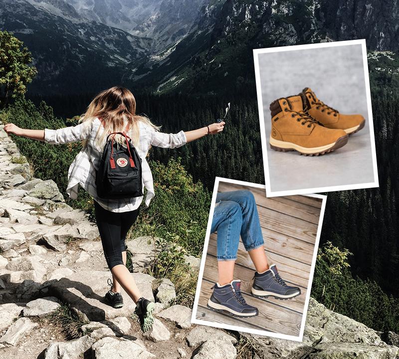 Dívka s batohem běžící po horské stezce v trekových botách